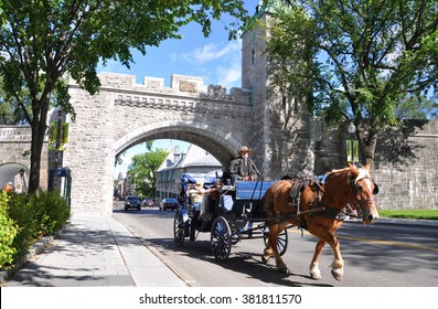 QUEBEC CITY, CANADA - SEP 10, 2011: Horse Carriage in front of St. Louis Gate in Quebec City. The Old Quebec was declared a World Heritage site by UNESCO in 1985.