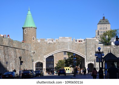 QUEBEC CITY, CANADA - SEP 11, 2011: Saint Jean Gate in Quebec City, Canada. The wall surrounds most of Old Quebec, which was declared a World Heritage site by UNESCO in 1985.