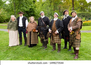 Quebec City, Quebec, Canada, September 7, 2019 - Group of participants in the Quebec Celtic Festival held in Domain de Maizerets posing wearing their Clan Wallace costumes