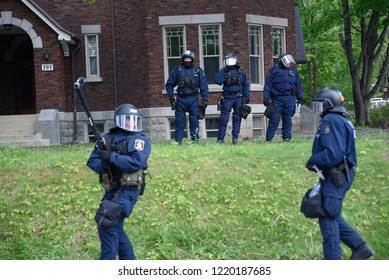 QUEBEC CITY - JUNE  7: Riot police officers patrolling a neighborhood during a rally to protest the G7 summit  on June 7  2018 in  Quebec City ,Canada