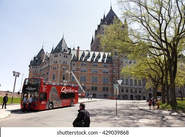 QUEBEC CITY - MAY 23, 2016: A hop-on-hop-off tourist bus is a very popular way for tourists to see the attractions of Quebec City.