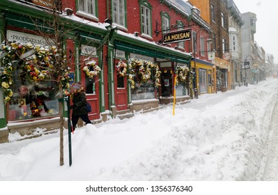 QUEBEC CITY QC/CANADA DECEMBER 13 2017 Snowy Rue St Jean in Quebec City during a heavy snowstorm, with the famous shop JA Moisan