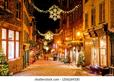QUEBEC CITY QC/CANADA DECEMBER 20 2017 Christmas decorations and fresh snow in Quebec City's Petit Champlain area at night in Rue Sous -le-Fort
