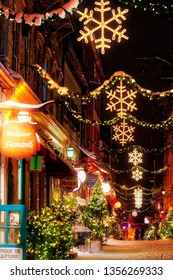 QUEBEC CITY QC/CANADA DECEMBER 20 2017 Christmas decorations and fresh snow in Quebec City's Petit Champlain area at night - in Rue Petit Champlain