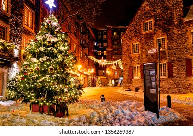 QUEBEC CITY QC/CANADA DECEMBER 20 2017 Christmas decorations and fresh snow in Quebec City's Petit Champlain area at night - in the Rue de Cul-de-Sac