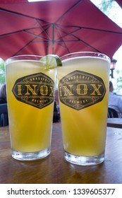 QUEBEC CITY QC/CANADA MAY 25 2018 Two pints of wheat beer on a table at the Inox pub on Grande Allée in Quebec City