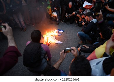 "QUEBEC CITY-JUNE 7: People surrounding a burning ""American Flag"" during a rally to protest the G7 summit  on June 7  2018 in  Quebec City ,Canada"