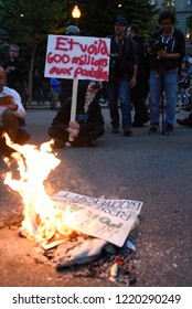 QUEBEC CITY-JUNE 7: Protesters sitting in front of burning signs during a rally to protest the G7 summit  on June 7  2018 in  Quebec City ,Canada