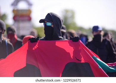 QUEBEC CITY-JUNE 8:  Black anarchist protesters carrying a banner during a rally to protest the G7 summit  on June 8 2018 in  Quebec City