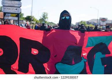 QUEBEC CITY-JUNE 8:  A Black anarchist protester chanting and shouting slogans during a rally to protest the G7 summit  on June 8 2018 in  Quebec City
