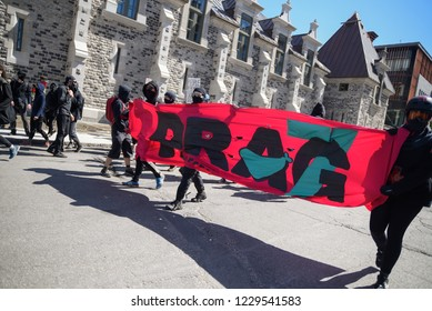 QUEBEC CITY-JUNE 8: Black anarchist protesters during a rally to protest the G7 summit  on June 8 2018 in  Quebec City,Canada