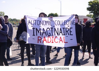 QUEBEC CITY-JUNE 8:  Black anarchist with signs and banners protesters during a rally to protest the G7 summit  on June 8 2018 in  Quebec City