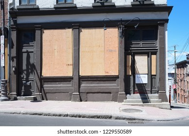 QUEBEC CITY-JUNE 8: Businesses erected a wooden wall in front of their glass window in fear of being vandalized during a rally to protest the G7 summit  on June 8 2018 in  Quebec City