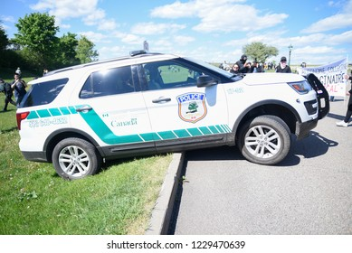 QUEBEC CITY-JUNE 8: A police car flipped while turning on a top of a hill during a rally to protest the G7 summit  on June 8 2018 in  Quebec City