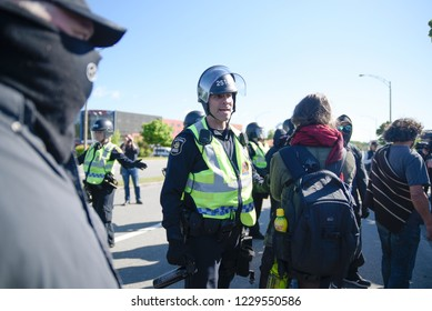 QUEBEC CITY-JUNE 8:  A police officer questioning the protesters during a rally to protest the G7 summit  on June 8 2018 in  Quebec City