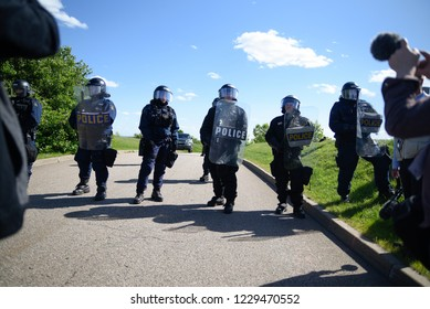 QUEBEC CITY-JUNE 8: Police officers protecting the hills side road during a rally to protest the G7 summit  on June 8 2018 in  Quebec City