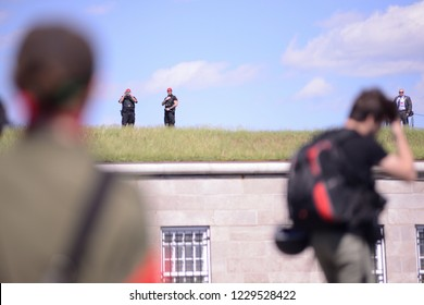 QUEBEC CITY-JUNE 8:  Police officers in uniform and civil dress keeping an eye on the protesters during a rally to protest the G7 summit  on June 8 2018 in  Quebec City