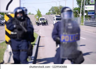 QUEBEC CITY-JUNE 8:  Police officers cordoned off the streets during a rally to protest the G7 summit  on June 8 2018 in  Quebec City,Canada.