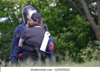 QUEBEC CITY-JUNE 8: A protester having a silent discussion with a riot police officer during a rally to protest the G7 summit  on June 8 2018 in  Quebec City
