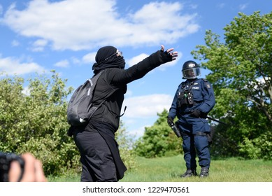 QUEBEC CITY-JUNE 8: Protesters arguing with the riot police officers during a rally to protest the G7 summit  on June 8 2018 in  Quebec City