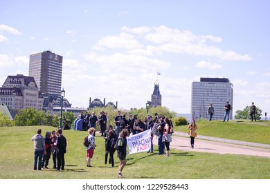 QUEBEC CITY-JUNE 8:  Protesters on their way to go on top of a foot hill during a rally to protest the G7 summit  on June 8 2018 in  Quebec City