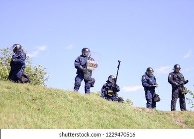 QUEBEC CITY-JUNE 8: Riot police officers protecting a hill top during a rally to protest the G7 summit  on June 8 2018 in  Quebec City