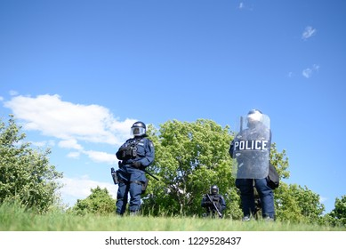 QUEBEC CITY-JUNE 8:  Riot police protecting a hilltop during a rally to protest the G7 summit  on June 8 2018 in  Quebec City