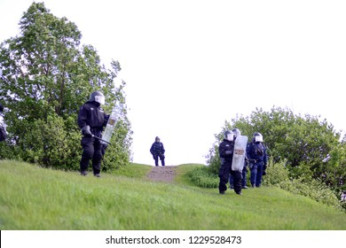 QUEBEC CITY-JUNE 8:  Riot police officers protecting the top most part of a hill during a rally to protest the G7 summit  on June 8 2018 in  Quebec City