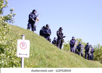 QUEBEC CITY-JUNE 8:  Riot police officers guarding a foot hill during a rally to protest the G7 summit  on June 8 2018 in  Quebec City