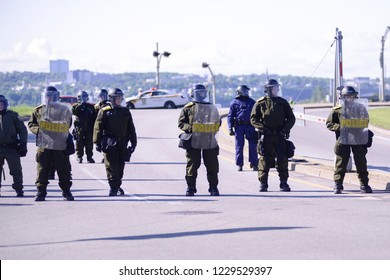 QUEBEC CITY-JUNE 8:  Riot police officers  forcing the protesters to stay a one particular place by barricading during a rally to protest the G7 summit  on June 8 2018 in  Quebec City