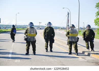 QUEBEC CITY-JUNE 8: Rot police cordoning off the highway during a rally to protest the G7 summit  on June 8 2018 in  Quebec City