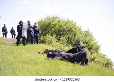 QUEBEC CITY-JUNE 8:  Two protesters lying down in front of the riot police as a mark of protest during a rally to protest the G7 summit  on June 8 2018 in  Quebec City