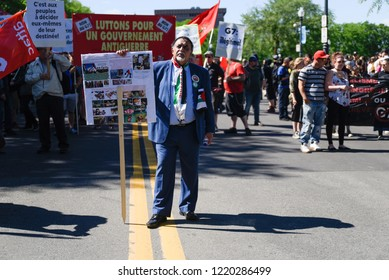 QUEBEC CITY-JUNE 9: A lone protester with images from happening in Palestine during a rally to protest the G7 summit  on June 9  2018 in  Quebec City ,Canada
