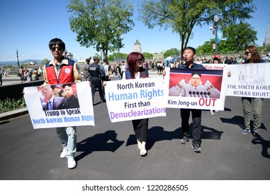 QUEBEC CITY-JUNE 9: North Korean protesters with signs speaking about human rights situation in North Korea  during a rally to protest the G7 summit  on June 9  2018 in  Quebec City ,Canada
