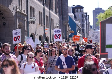 QUEBEC CITY-JUNE 9: People walking with banners and signs while chanting slogans during a rally to protest the G7 summit  on June 9  2018 in  Quebec City ,Canada
