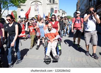 QUEBEC CITY-JUNE 9:  A protester on wheel chair participating in a rally to protest the G7 summit  on June 9  2018 in  Quebec City ,Canada