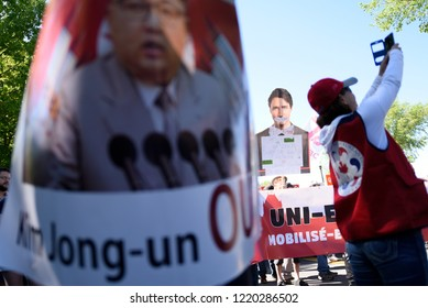 QUEBEC CITY-JUNE 9: Protesters with image of Kim Jong-un during a rally to protest the G7 summit  on June 9  2018 in  Quebec City ,Canada