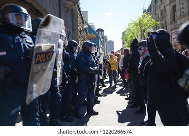 QUEBEC CITY-JUNE 9: Protesters and police facing off each other during a rally to protest the G7 summit  on June 9  2018 in  Quebec City ,Canada