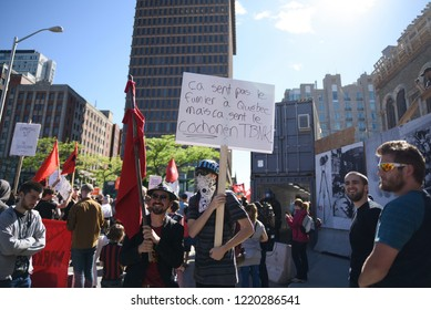 QUEBEC CITY-JUNE 9:  Protesters with signs and banners during a rally to protest the G7 summit  on June 9  2018 in  Quebec City ,Canada