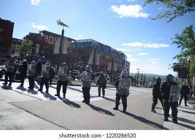 QUEBEC CITY-JUNE 9: Riot police officers forming a perimeter to protect important buildings during a rally to protest the G7 summit  on June 9  2018 in  Quebec City ,Canada