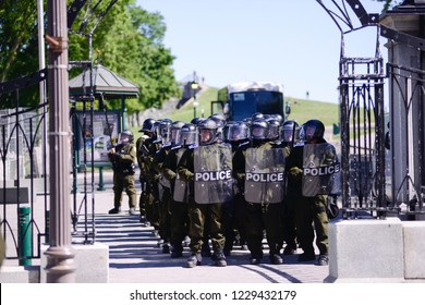QUEBEC CITY-JUNE 9: Riot police officers protecting the streets during a rally to protest the G7 summit  on June 9  2018 in  Quebec City ,Canada