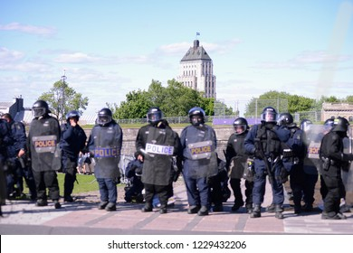 QUEBEC CITY-JUNE 9: Riot police protecting the streets during a rally to protest the G7 summit  on June 9  2018 in  Quebec City ,Canada