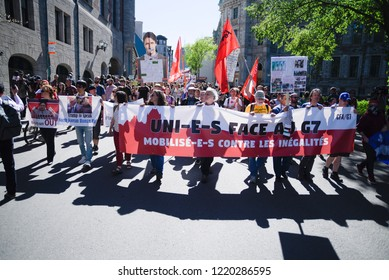 QUEBEC CITY-JUNE 9:Protesters walking with a cut out of Justin Trudeau while denouncing his policies during a rally to protest the G7 summit  on June 9  2018 in  Quebec City ,Canada