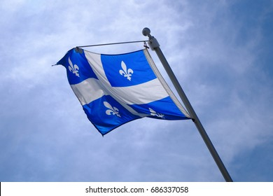 Quebec Flag pole on blue sky national st-jean banner