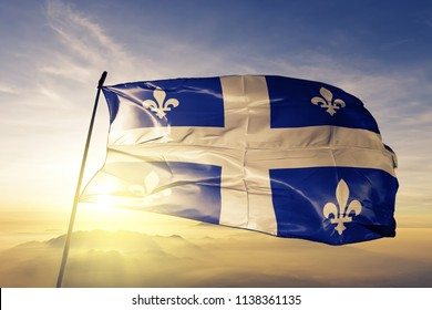 Quebec flag textile cloth fabric waving on the top