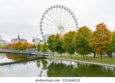 Quebec, OCT 2: Afternoon view of the beautiful fall color with the La Grande Roue de Montreal observation ferris wheel on OCT 2, 2018 at Quebec, Canada