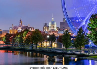 Quebec, OCT 2: Twilight view of the beautiful fall color with the La Grande Roue de Montreal observation ferris wheel on OCT 2, 2018 at Quebec, Canada