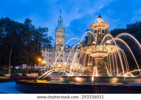 The Quebec Parliament Building and the Fontaine de Tourny at twilight in Quebec City, Quebec, Canada.