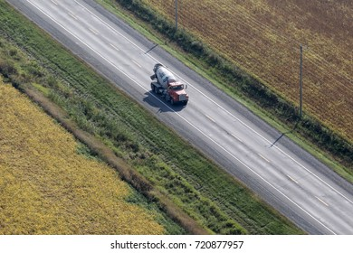 Quebec, September 20, 2017. Aerial view looking at a cement truck traveling on a country aide road in rural Quebec, Canada.