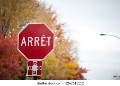 Quebec Stop Sign, obeying by bilingual rules of the province imposing the use of French language on roadsigns, thus translated Stop into Arret, taken in the streets of Montreal, Canada